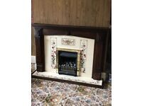 Gas fire and surround, with tiled back and base.