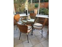 M&S glass dining table and 4 wicker chairs