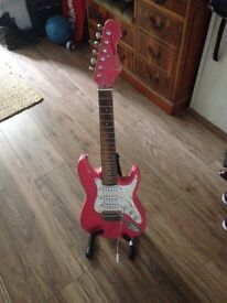 As new beautiful pink kids guitar with speaker