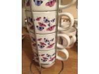 Four New mugs in a stand