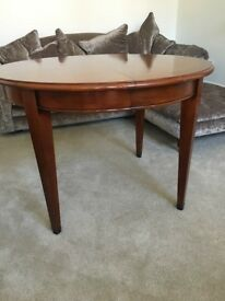 French polished dining table. Extends to large oval table.