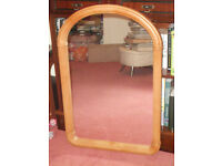 Lovely large glass mirror with detailed surround and arched top.
