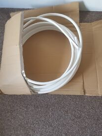 White plastic coated copper pipe 10mm x 12 metre length (approx) coiled central heating etc.
