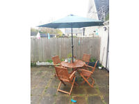 Very good condition Garden Table and chairs with umberalla - Collection from witney ASAP