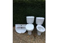 2 x White Toilets & 1 x Basin