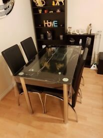 black and chrome 4 seater dining table with chairs
