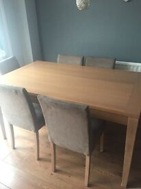 Light oak dining table with 6 chairs