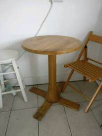 Small round wooden dining table.