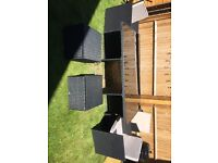 Rattan garden table with three chairs and two foot stalls/storage units.