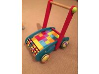 Beautiful traditional baby walker by Janod with blocks