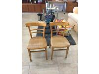 2 wooden dinning chairs