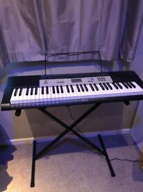 Casio CTK-1550AD keyboard with stand and headphones
