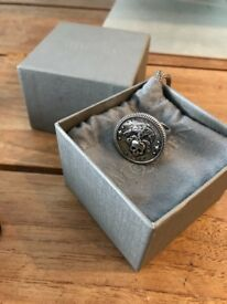 Men's Size UK 21, Alexander Mqueen. Signet ring in silver-tone brass. Engraved logo, carved detail