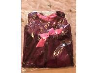 Avon bow reversible dress 2-3 years brand new.