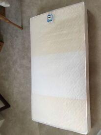 Baby cot mattress.