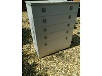 White chest of drawers with silver metal handles