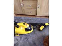 Little yellow steam cleaner with attachments