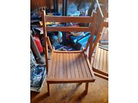 Two wooden fold up chairs , iseal for indoors or outside