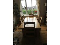beech wood dining room table and 6 chairs.
