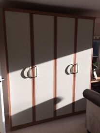 Two double door fitted beech/cream wardrobes. Very good condition.