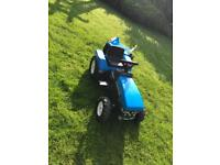 Ride on blue ford tractor