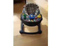 Graco baby walker with detachable play tray.