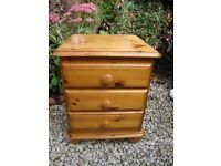Pine Three Drawer Bedside Unit.