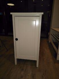 Ikea bedside cupboards, in cream.