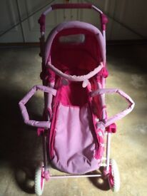 Dolls pram pink& white with removable carry cot & storage tray very little used.