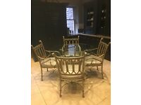 Glass round dining table and four chairs upholstered in a Romo champagne fabric. Diameter 122cm's