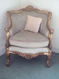 A pair of identical gilded Salon chairs