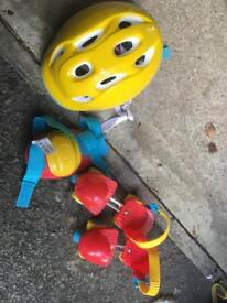 Roller skates, helmet and pads
