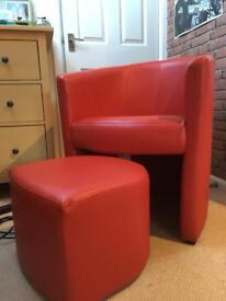 Imitation red leather tub chair with foot stall.