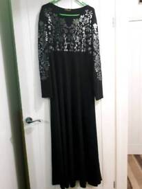 Black Abaya with silver embroidery on front bodice. Length 56 inches