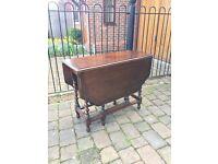 Antique drop lead table in mahogany