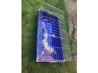 Indoor rabbit/guinea pig cage. Carry case also. All used but in fair condition.