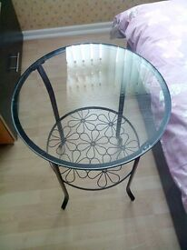 Black metal and glass coffee table and black metal and glass cabinet