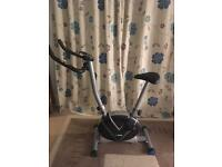 Exercise bike, yoga mat and ab wheel