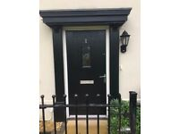 Black front door- comes with window, handles, letterbox and viewer.