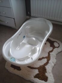TEGA baby bath with built in seat and thermometer