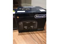 De longhi kettle and 4 slice toaster black never been opened!!