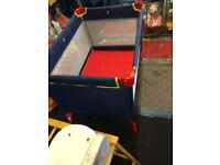 Red travel cot