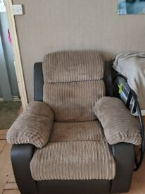 Brown 2 seater sofa and a reclining armchair