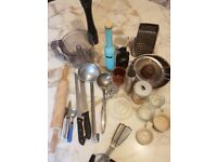 kitchen utensils and cups saucers