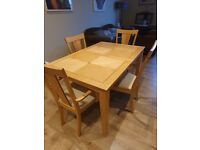 Inlaid dining table and four chairs
