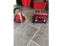 Matching red kettle, toaster and microwave