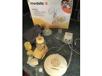 Medela swing breast pump plus extras