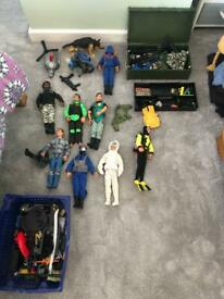 Various 1990 Action Man dolls and vehicles.