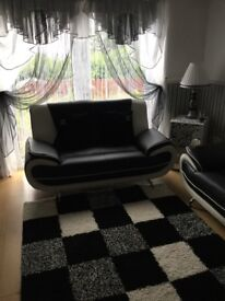 BLACK LETHER SOFAS 3+2
