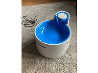 Pet water fountain with spare filters